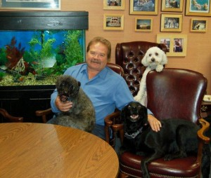 CMA CEO Jeff Barnhart and his three dogs and fish in his office.