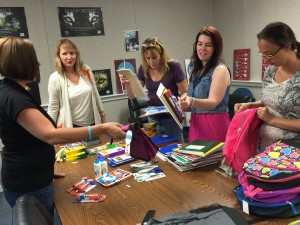 CMA crew members collecting supplies for a fundraiser.